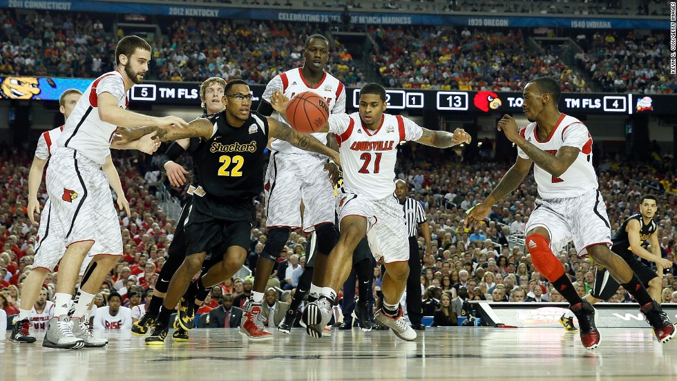 Carl Hall of Wichita State (22) reaches for the ball against (from left) Luke Hancock, Gorgui Dieng, Chane Behanan and Russ Smith of Louisville.