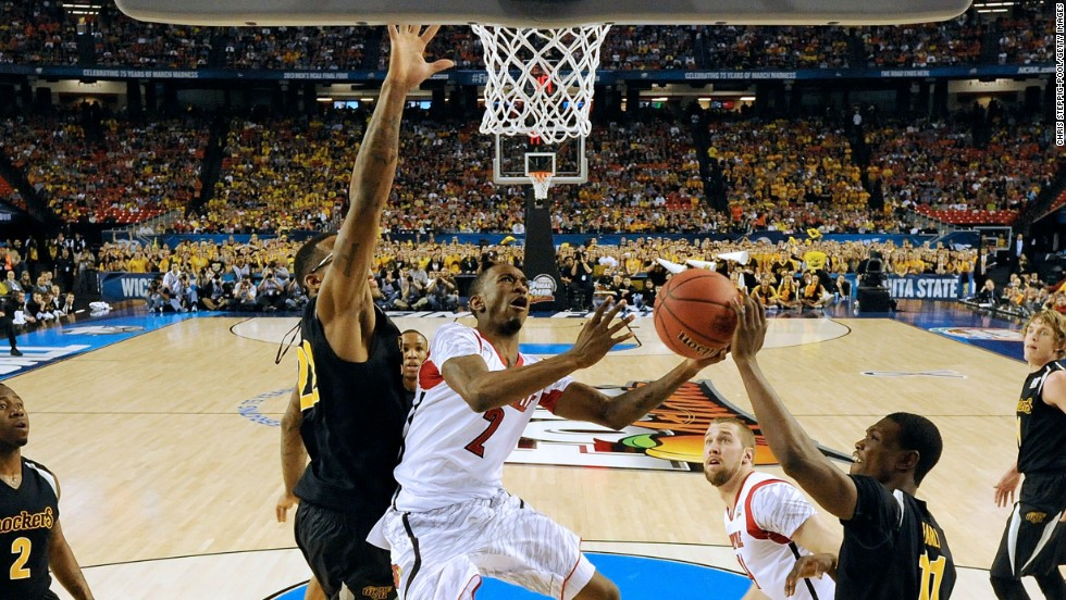 Russ Smith of the Louisville Cardinals drives for a reverse layup against Hall and Early of Wichita State.