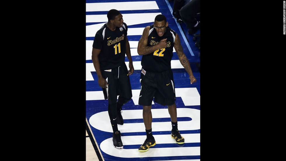 Cleanthony Early, left, and Carl Hall, right, of Wichita State react in the second half.