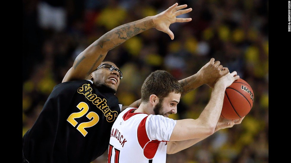 Louisville's Luke Hancock attempts to control the ball against Wichita State's Carl Hall.