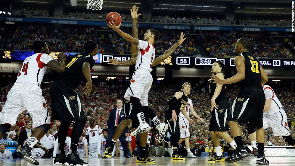 "Peyton Siva of the Louisville Cardinals goes up for a layup against the Wichita State Shockers on Saturday, April 6, in Atlanta in the first of the day's semifinal matchups in the 2013 NCAA men's basketball tournament. Louisville beat Wichita State with a final score of 72-68. Check out the action from the Final Four and <a href=""http://www.cnn.com/2013/04/06/us/gallery/final-four-syr-mich/index.html"" target=""_blank"">look at the second game between Syracuse and Michigan</a>."