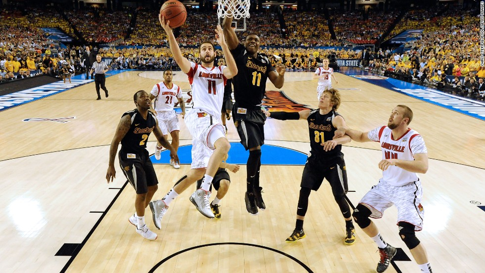 Luke Hancock of Louisville drives for a shot against Cleanthony Early of Wichita State.