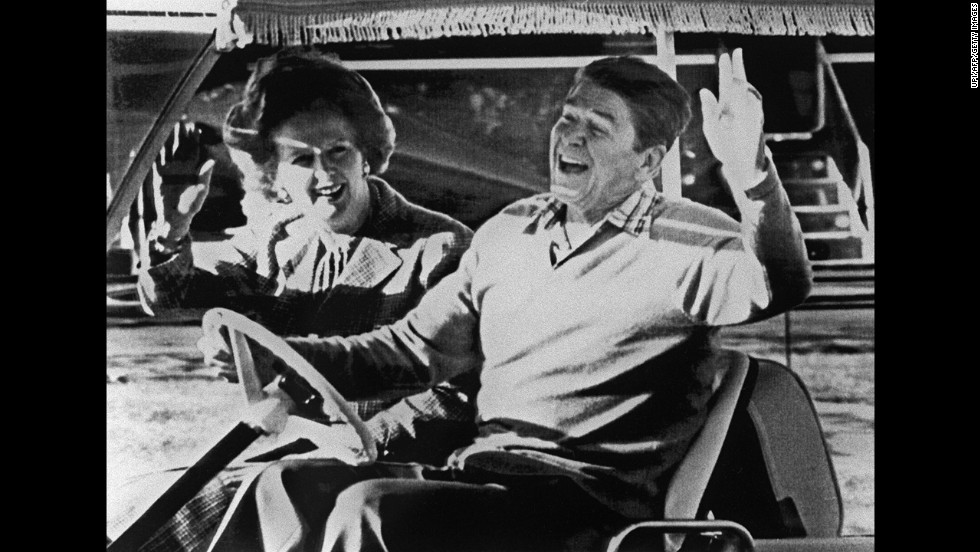 Reagan and Thatcher take a golf cart around Camp David in December 1984.