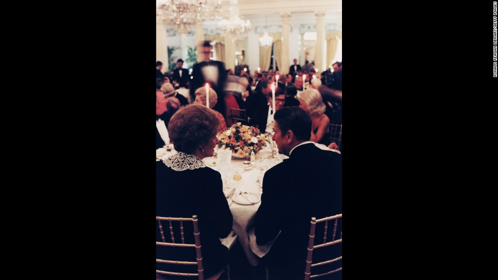 Thatcher and Reagan chat at a British Embassy dinner in Washington in February 1981.