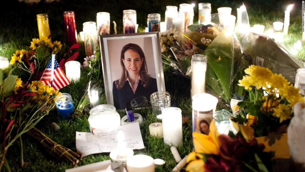 A framed photograph of Giffords stands at the center of a memorial during a candlelight vigil at the University Medical Center on January 8, 2011. The congresswoman was shot in the head during an event that day in front of a Safeway grocery store in Tucson, Arizona.  Six people were killed. The gunman, Jared Lee Loughner, was sentenced to life in prison without parole in 2012.