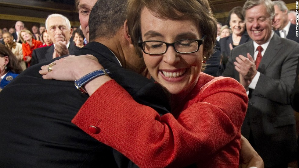 President Barack Obama embraces Giffords as members of Congress applaud before his State of the Union address in Washington on January 24, 2012.