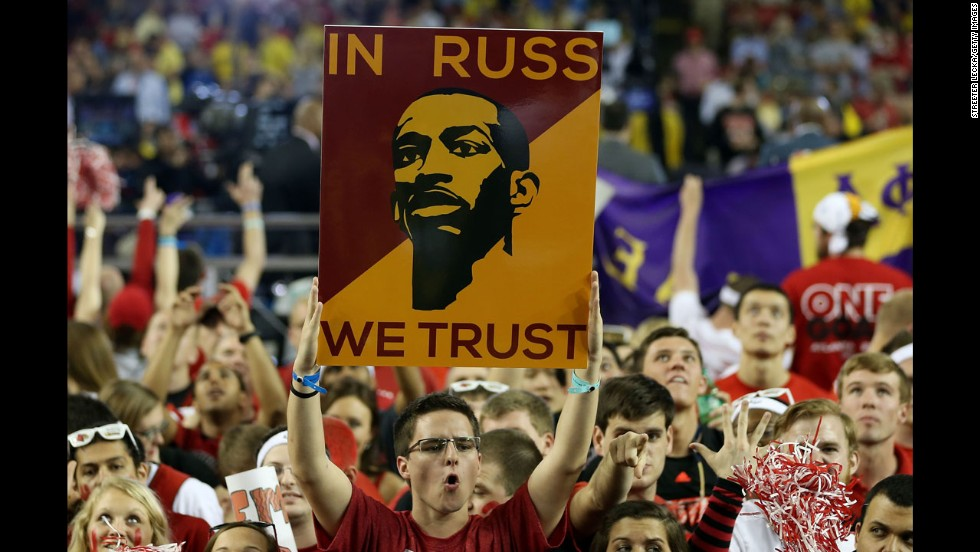A Louisville fan holds up a sign supporting Russ Smith of Louisville.