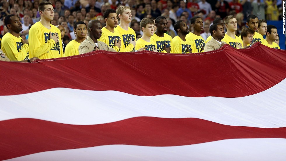 The Michigan Wolverines stand during the national anthem.