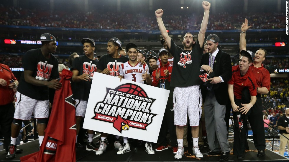 The Louisville Cardinals celebrate after they win 82-76 against the Michigan Wolverines.