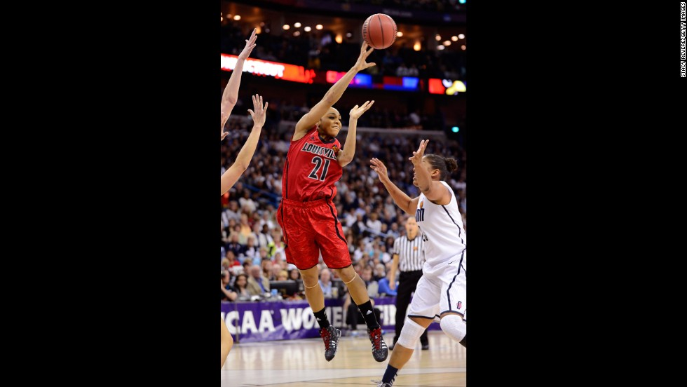 Bria Smith of Louisville looks to make a pass over Kaleena Mosqueda-Lewis of UCONN on April 9.