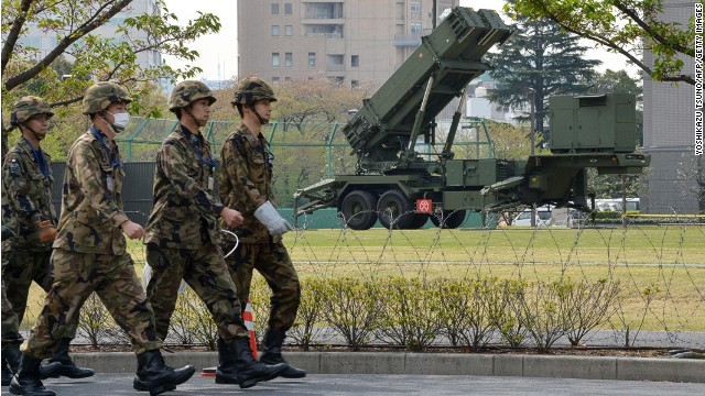 Officers of Japan's Ground Self-Defense Force (SDF) walk in front of Patriot Advanced Capability-3 (PAC-3) surface-to-air missile launchers at the Defence Ministry in Tokyo on April 9, 2013. Japan has deployed Patriot missiles in its capital as it readies to defend the 30 million people who live in greater Tokyo from any North Korean attack. AFP PHOTO / Yoshikazu TSUNO (Photo credit should read YOSHIKAZU TSUNO/AFP/Getty Images)