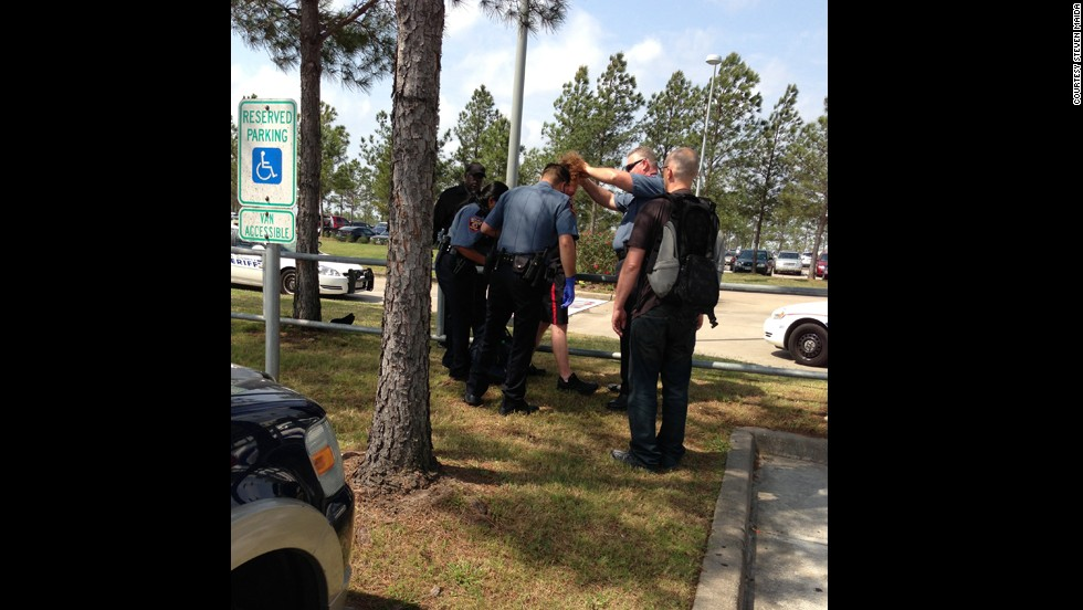 Maida posted this photo of officers restraining the suspect.