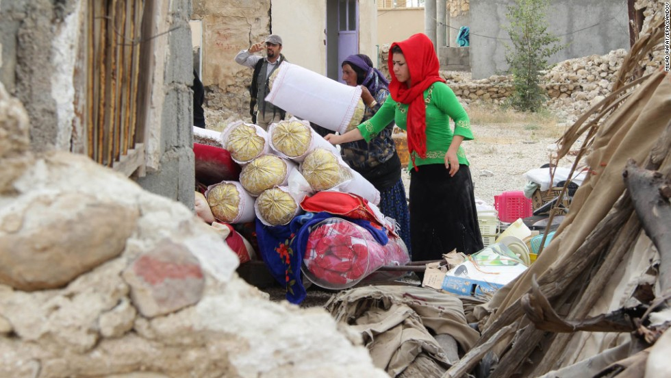 Villagers collect their belongings from the rubble in Shanbeh on April 10 after the quake.