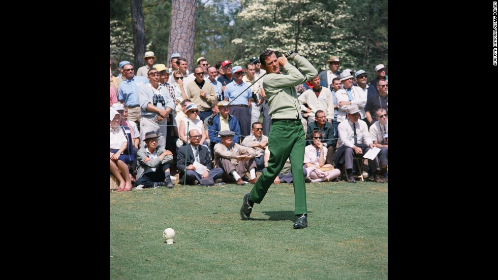 "Doug Sanders, one of golf's earliest flamboyant dressers, tees off on the second hole during the 1966 Masters. His knack for lively fabrics earned him the nickname ""Peacock of the Fairways."""