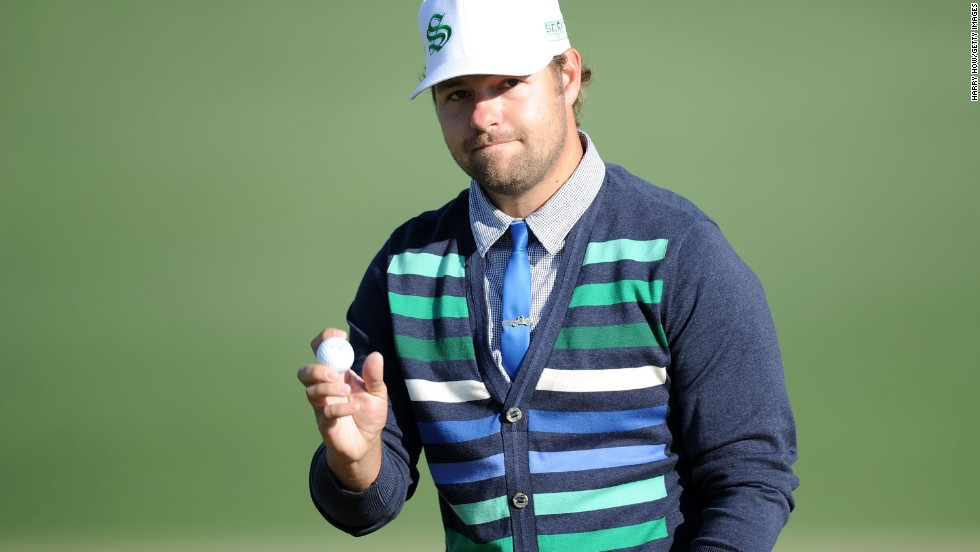 "Ryan Moore, <a href=""http://bleacherreport.com/articles/2023504-masters-par-3-tournament-2014-results-analysis-and-twitter-reaction"" target=""_blank"">who won the traditional Par 3 Contest at this year's Masters</a>, is known to sport a skinny tie with a cardigan. Here, he waves to the gallery on the second green during the 2010 Masters."