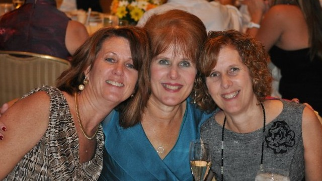 Sisters Mary Scherlach, center, Jane Dougherty, right, and Sue at Mary's daughter's 2010  wedding.