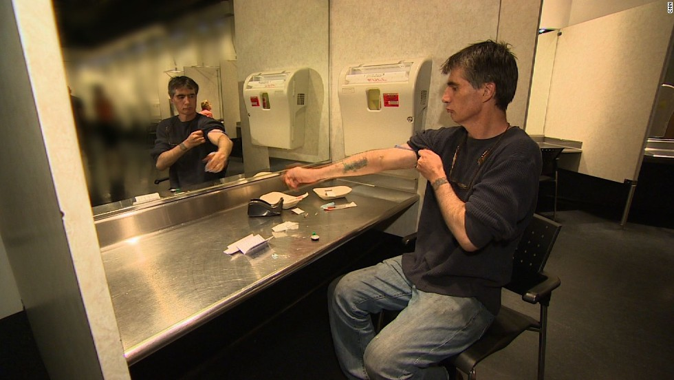 Insite is a supervised drug injection center in Vancouver, Canada. Pictured, Steve, a long-term heroin addict, prepares to inject himself.