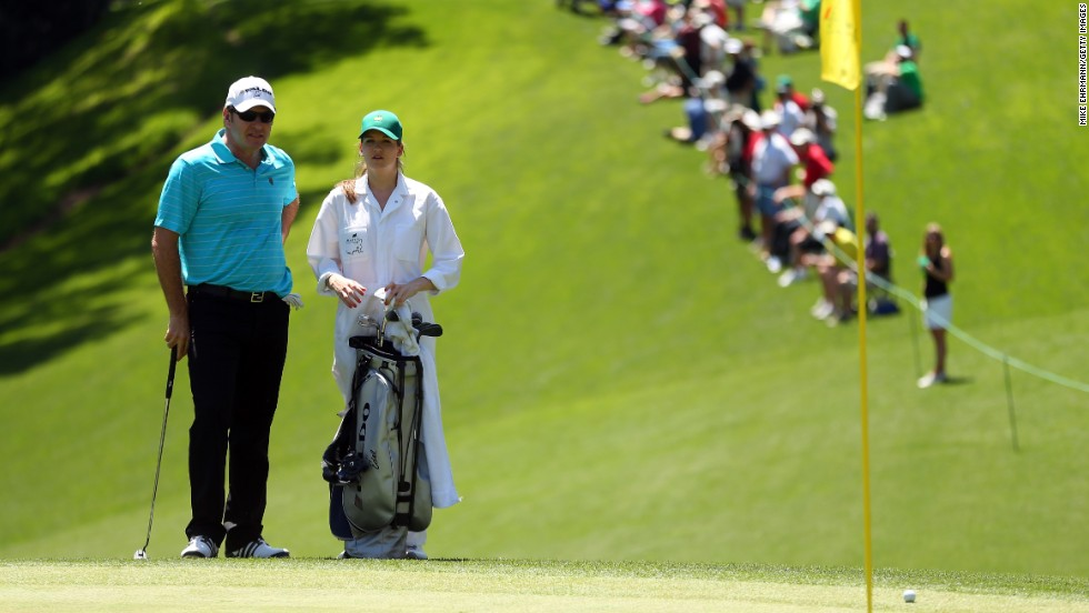 Nick Faldo of England stands with his daughter, Emma Scarlet, during the Par 3 Contest.