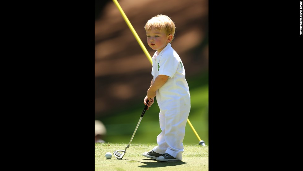 Chase, son of John Merrick of the United States, gets ready to putt.