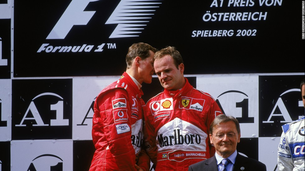 Rubens Barrichello (right) looks far from content as teammate Michael Schumacher has a quiet word on the podium following the 2002 Austrian Grand Prix, which the German controversially won. The Brazilian, who spent six years as Schumacher's deputy at Ferrari, says he empathizes with Webber's position at Red Bull.