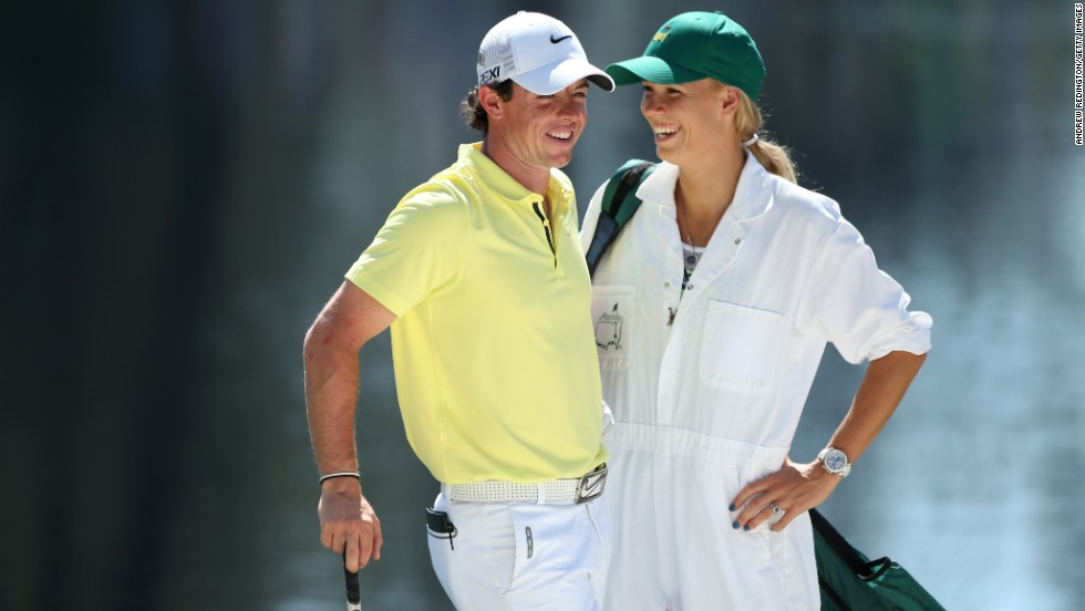 Rory McIlroy of Northern Ireland stands with his caddie (and professional tennis player) Caroline Wozniacki during the Par 3 Contest before the start of the 2013 Masters Tournament at Augusta National Golf Club in Georgia on Wednesday, April 10.