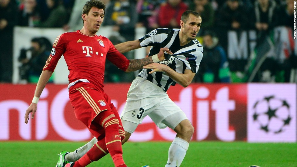 Bayern Munich's Mario Mandzukic and Juventus' Giorgio Chiellini challenge for the ball during the second leg of the Champions League quarterfinal tie. Bayern won the opening contest 2-0 last week and arrived in Italy just days after winning the German title.