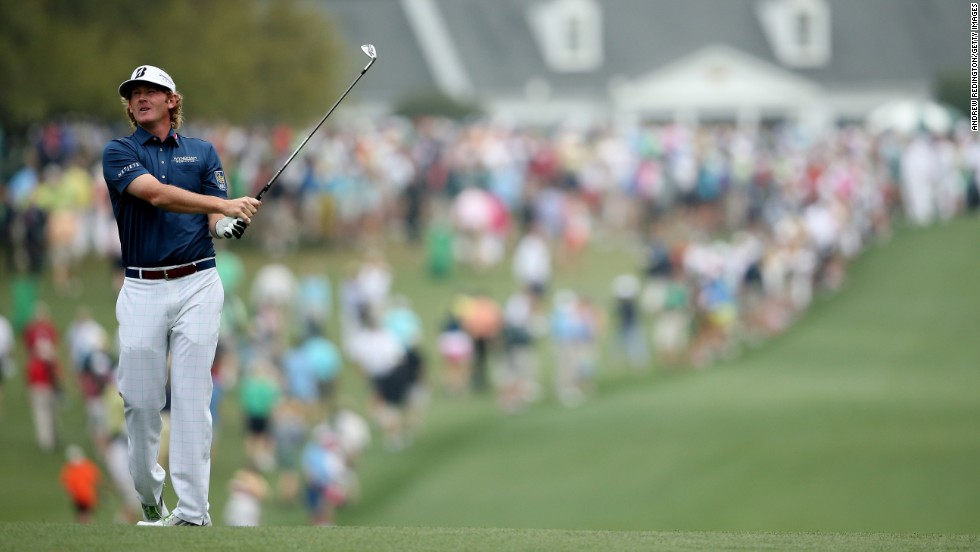 Brandt Snedeker of the United States hits his second shot on the first hole.