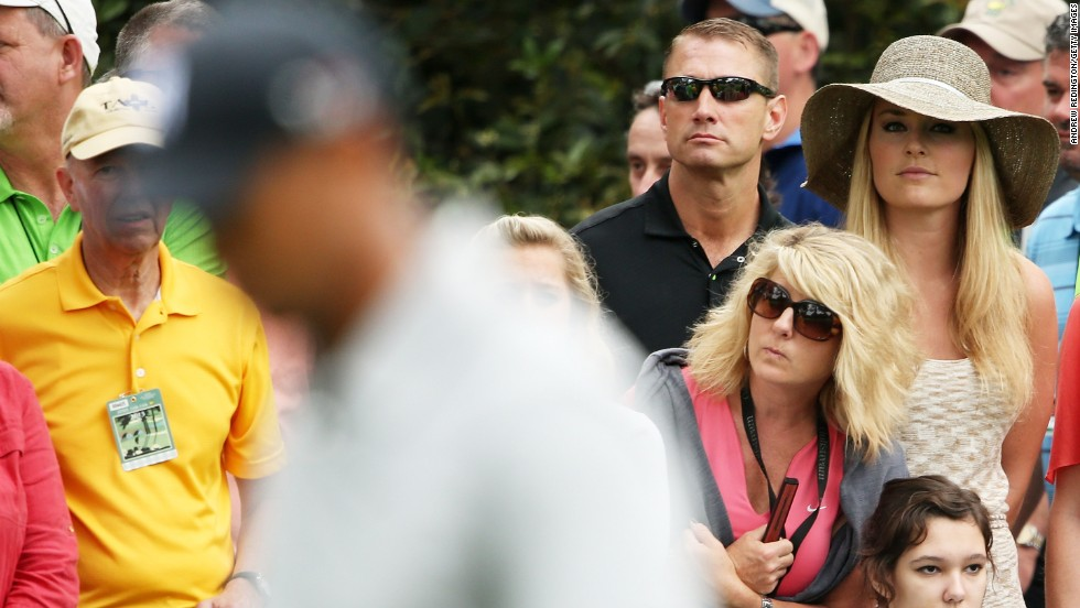 Skier Lindsey Vonn watches Tiger Woods play the first hole. Vonn and Woods have said they are dating.