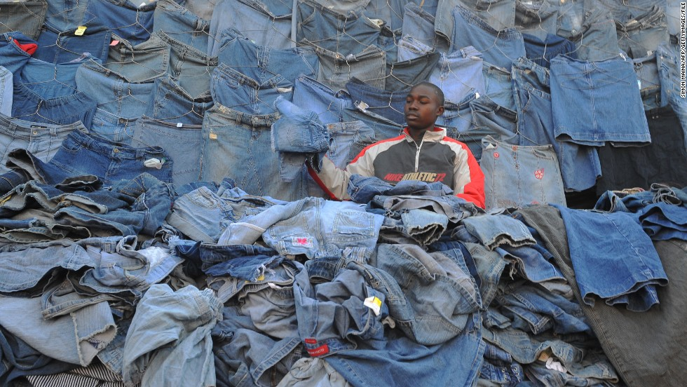 A vendor sells second-hand clothes in Nairobi, Kenya. Some analysts say the influx of Western used clothes curtails local clothing production and hinders economic development.