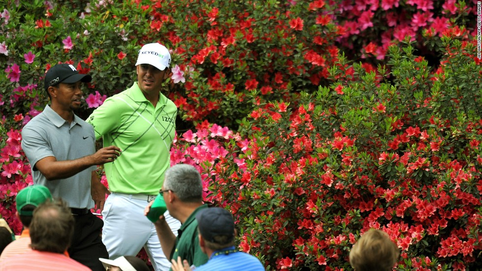 Tiger Woods and Scott Piercy of the U.S. walk together during the first round.