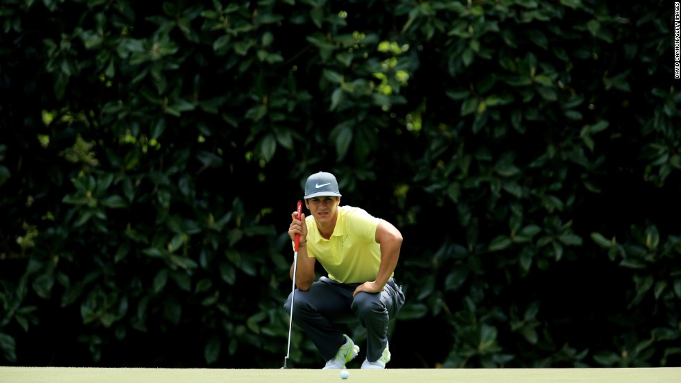 Thorbjorn Olesen of Denmark lines up a putt on the fifth hole.