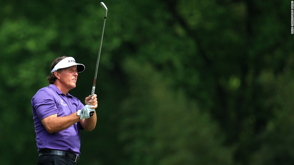 Phil Mickelson of the U.S. hits a shot on the fifth hole.