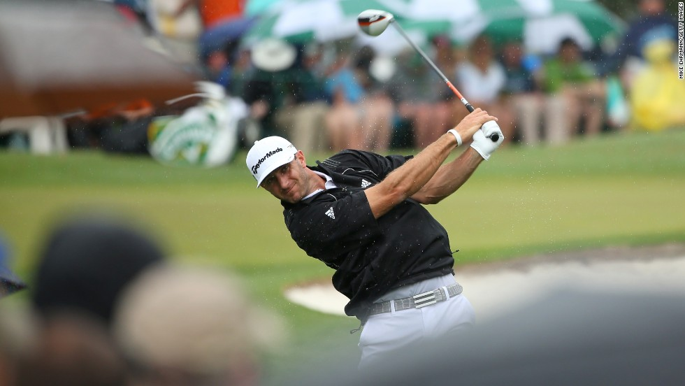 Dustin Johnson of the U.S. hits a shot on the third hole.