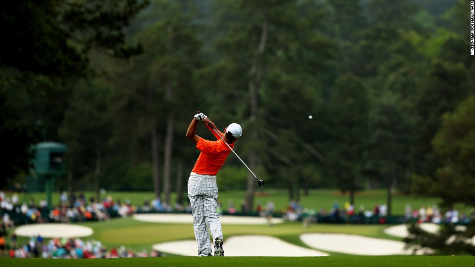 Guan Tianlang of China hits a shot from the second fairway.