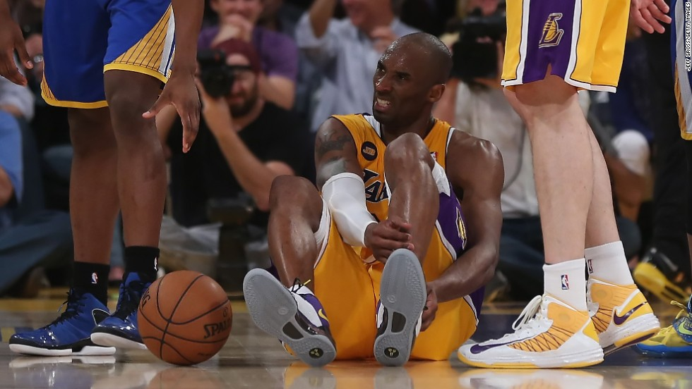 Bryant is injured in the second half while playing the Golden State Warriors on April 12, 2013. The injury took him out of the rest of the 2012-2013 season.