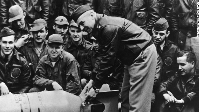 "Lt. Col. James Doolittle leans over a bomb on the USS Hornet deck just before his ""Raiders"" began the bombing raid on Tokyo."