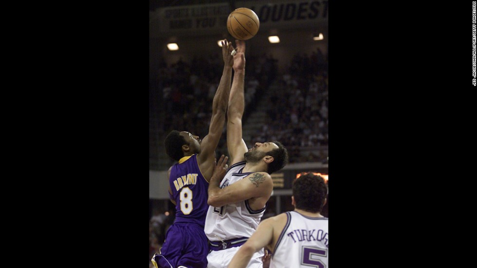 Vlade Divac, No. 21 of the Sacramento Kings, jumps for the ball against Bryant during game four of the Western Conference Semifinals at Arco Arena on May 13, 2001, in Sacramento, California.