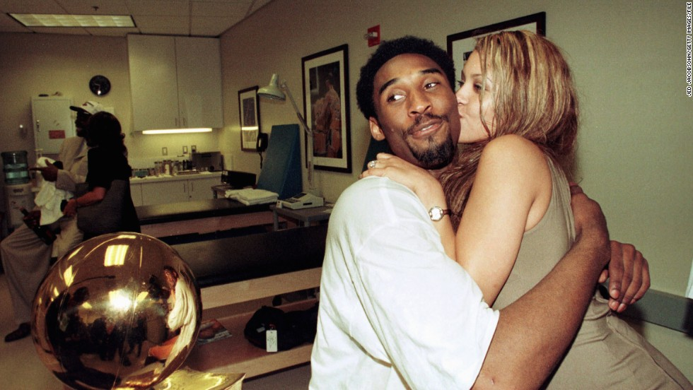 Bryant hugs his fiance, Vanessa Laine, while in the locker room after the Lakers defeated the Indiana Pacers in game six of the 2000 NBA Finals to win the series 4-2 on June 19, 2000, in Los Angeles. Bryant later married Laine, and they have two children.