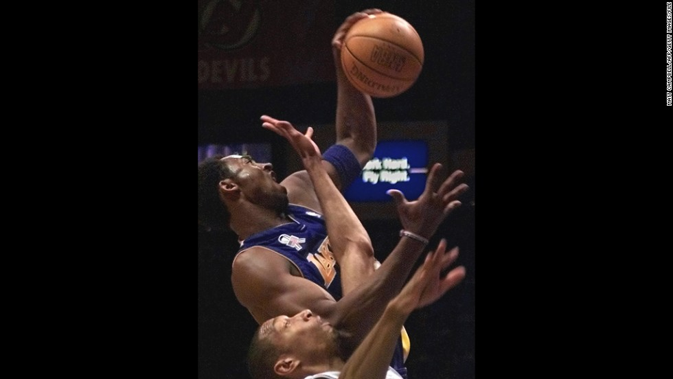 Bryant, top, and New Jersey Nets guard Kerry Kittles fight for a rebound in the first quarter on April 3, 2002, at Continental Airlines Arena in East Rutherford, New Jersey.