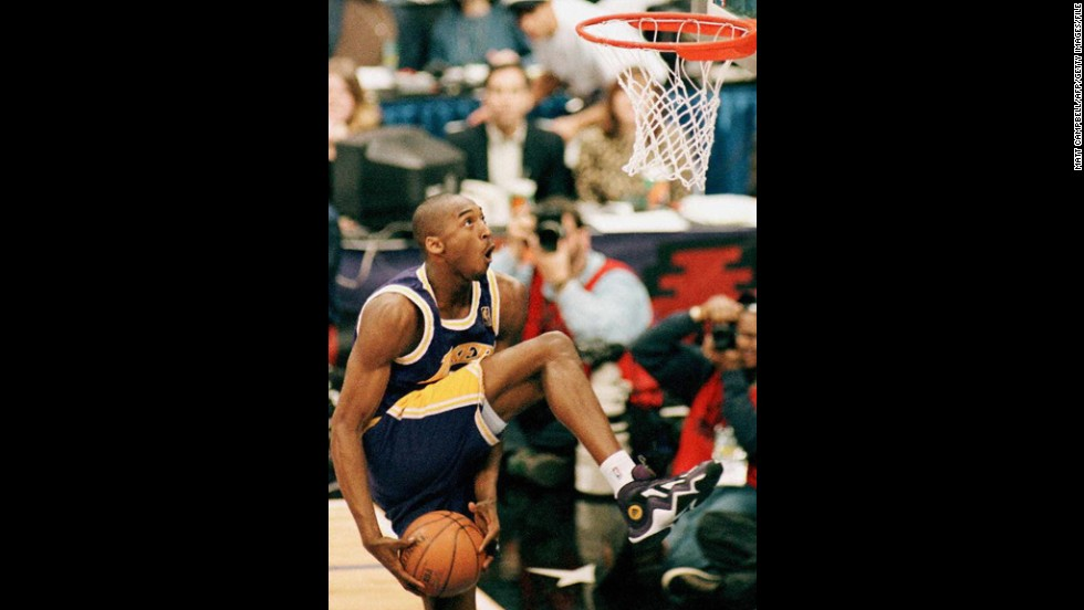 Bryant eyes the basket during the NBA Slam Dunk contest on February 8, 1997, at Gund Arena in Cleveland. Bryant is the youngest player to win the contest.