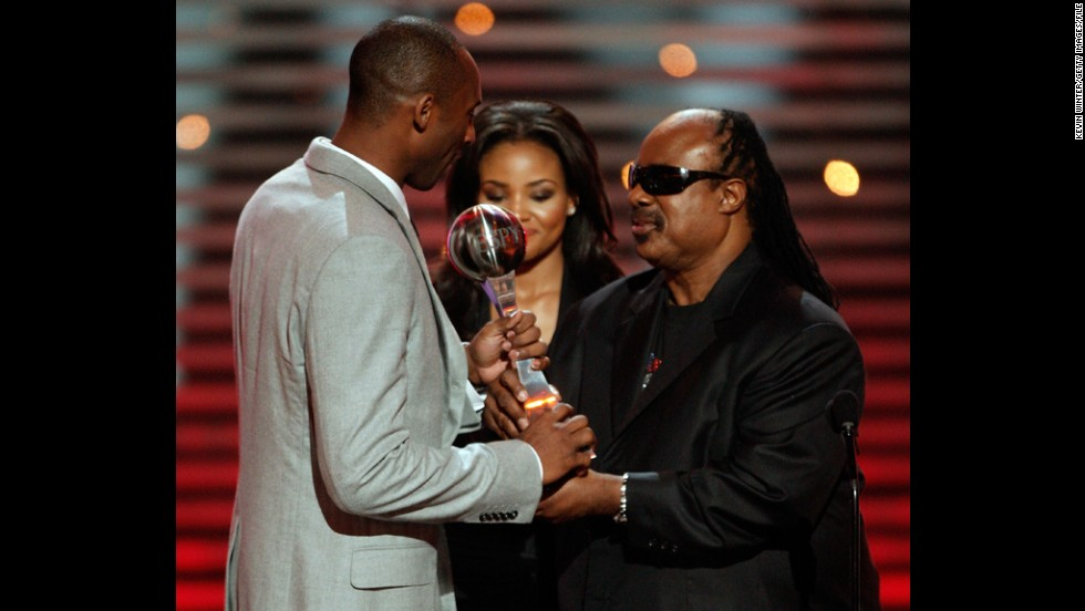 Bryant accepts the best team award on behalf of the Los Angeles Lakers from musician Stevie Wonder during the 2009 ESPY Awards held at Nokia Theatre LA Live on July 15, 2009, in Los Angeles.