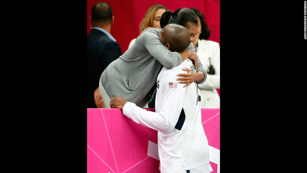 U.S. first lady Michelle Obama hugs Bryant after the  United States played France at the Olympics on July 29, 2012.