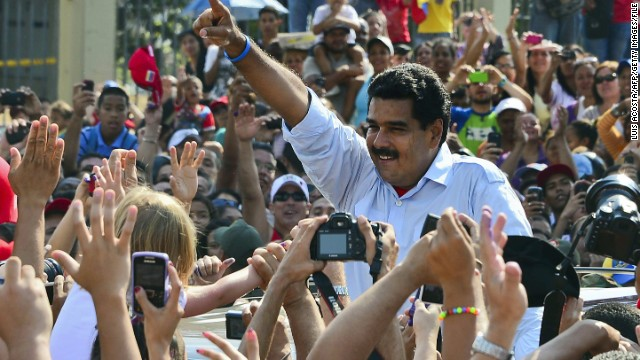 Nicolas Maduro waves at supporters after casting his vote in Caracas, Venezuela, on Sunday.