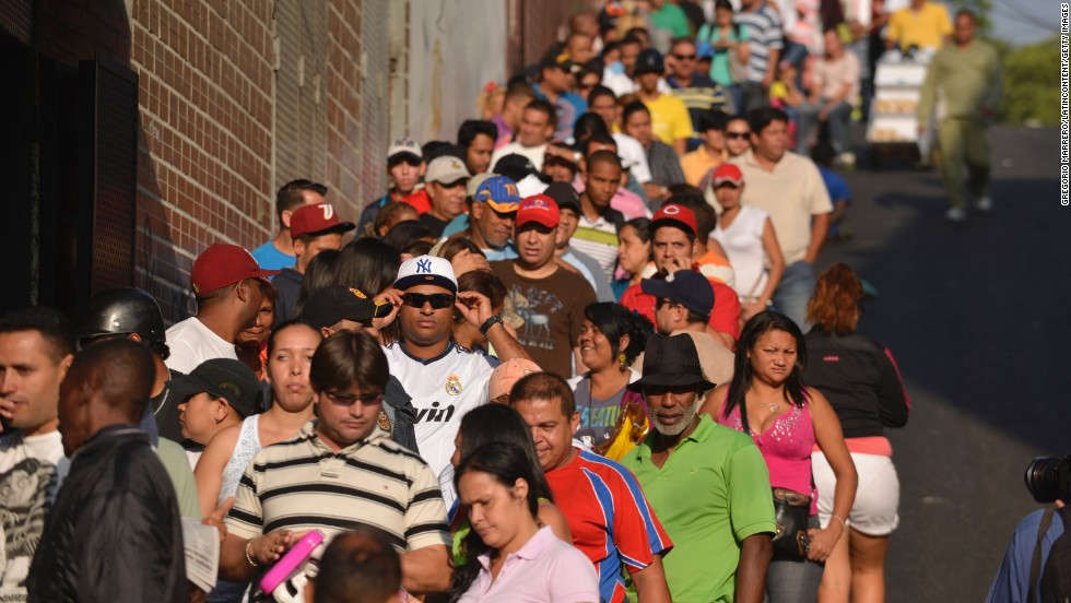People wait at a voting center in Caracas.