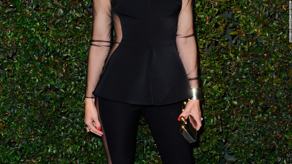 Gwen Stefani is classy but edgy in leggings and a matching peplum top.