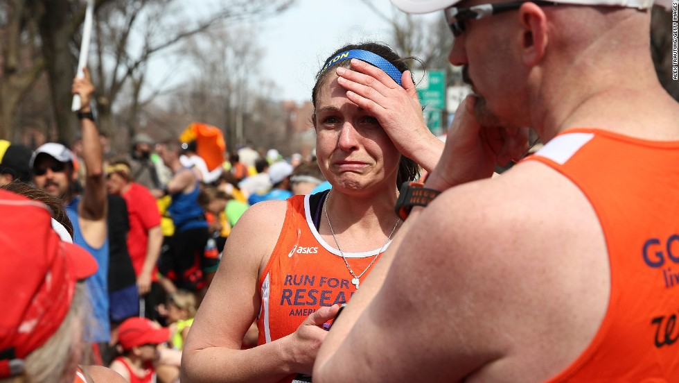 Runners react near Kenmore Square after the explosions.