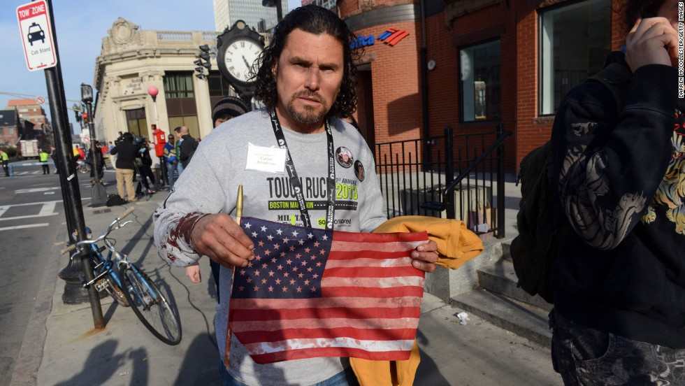 "<a href=""http://www.cnn.com/2013/04/16/us/boston-heroes/index.html"">Carlos Arredondo</a> was at the race handing out American flags to spectators. After the blasts, he helped emergency responders and is credited with helping a man survive serious leg wounds."