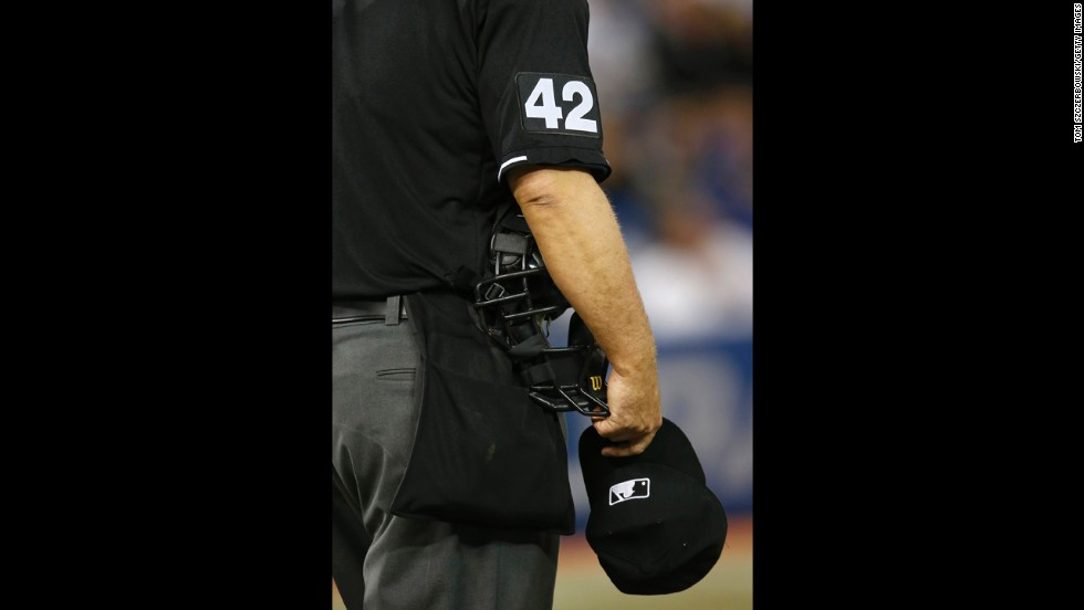 Home plate umpire Tony Randazzo stands on the field wearing No. 42 during the game between the Chicago White Sox and Toronto Blue Jays.