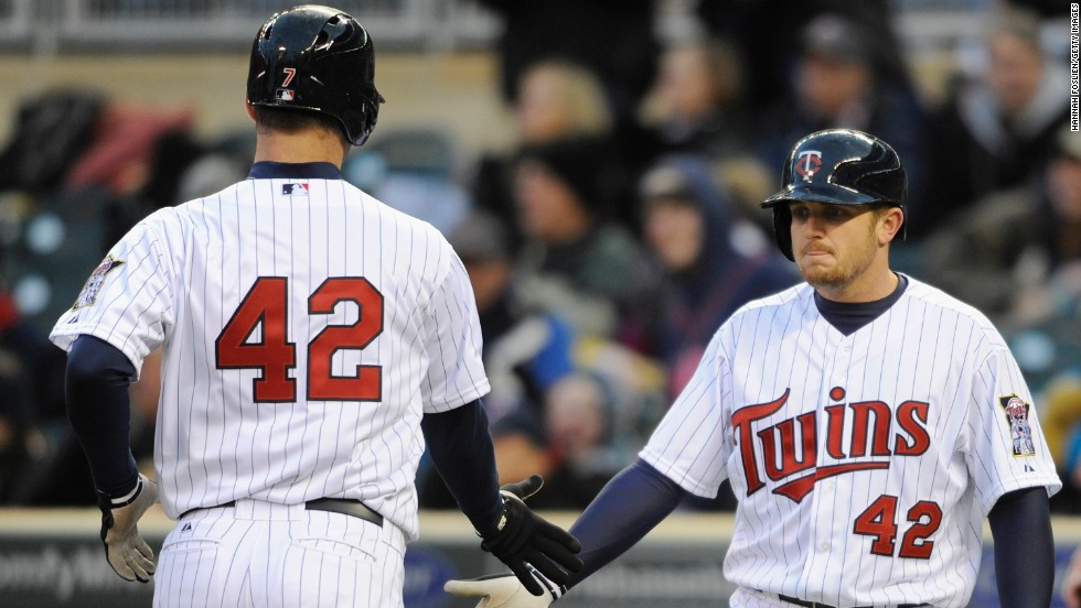Chris Parmelee, right, of the Minnesota Twins congratulates teammate Joe Mauer on scoring a run against the Los Angeles Angels of Anaheim at Target Field in Minneapolis.