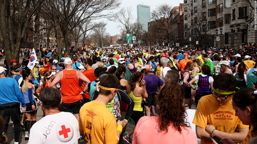 Runners gather near Kenmore Square after the explosions.